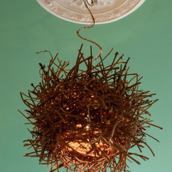 Roost Pendant - A welcoming light shines through this hand-made pendant lamp.