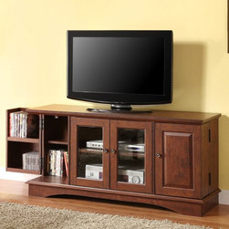 Walker Edison - Walker Edison 52-in. Media Storage Wood TV Console - Traditional Brown - HNQ52C4 - Shop for Visual Centers and Stands from Hayneedle.com! We know how messy TV rooms can get with all those discs cords and remotes. That's why we recommend the Walker Edison 52-in. Media Storage Wood TV Console - Traditional Brown. Durably constructed with laminate and MDF (a dense warp-resistant engineered wood) this sturdy TV console offers multiple storage features to keep all your equipment organized. Two outer wood-panel doors open and fold outward revealing eight shelves specially designed for DVDs Blu-ray discs and CDs. The center cabinet houses two shelves behind two glass-paned doors that allow remote signals to pass through easily. Not too traditional but not too modern this super-practical TV console boasts a warm brown finish and brass-finished knobs. The stand's spacious top holds most flat panel TVs measuring up to 52 inches wide.About Walker EdisonSpecializing in quality furniture at low prices Walker Edison Furniture Company manufactures a wide variety of furniture pieces for the North American marketplace. From bedroom furniture and desks to coffee tables dining tables and TV stands Walker Edison provides practical decor solutions for today's functional homes. With factories strategically located all over the world Walker Edison balances cost with low-priced raw materials and skilled artisans to deliver smart furniture pieces that fit every budget.