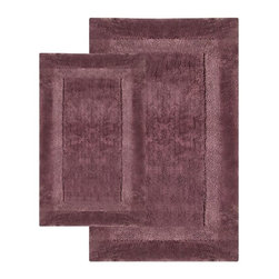 Chesapeake Merchandising - 2 Piece Olympia Bath Rug Set - 37650 - Shop for Mats and Rugs from Hayneedle.com! Keep those feet cozy and dry with the help of the 2 Piece Olympia Bath Rug Set. Step out of the shower and onto ultra-soft 100% tufted-cotton goodness. The non-slip latex backing will assure you a safe step while the super-absorbent power of cotton whisks all traces of water away. Set Dimensions: Large rug: 24 x 40 inches Small rug: 21 x 34 inches About Chesapeake Merchandising Inc. Started in Maryland in 1995 Chesapeake Merchandising Inc. remains dedicated to producing quality textiles from the finest raw materials. Purveyors of fine rugs linens pillows and bedding they strive to stay abreast on the latest trends in the industry in order to provide their customers with the most up-to-date styles for their homes. Chesapeake employs dedicated workers with a passion for quality. Their facilities are located in both India and the United States; their permanent showroom is located in New York New York.