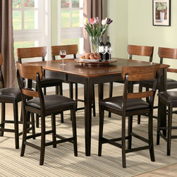 Coaster - Franklin Counter Height Table - Offered in a two tone oak and brown finish, this beautiful counter height dining table and chair set will add a sophisticated style to your casual dining or entertainment space. The smooth table top has rounded edges and features a convenient leaf so the length can be extended from 36 to 54 inches, allowing you to easily accommodate guests. Turned tapered legs are fresh but timeless, giving this table a transitional style that will blend nicely into any home. The matching stool feature updated back slats with brown vinyl seating for supreme comfort.