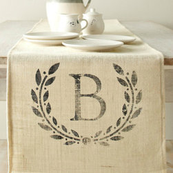Personalized Table Runner - Anything monogrammed automatically feels more personal, and this hemp-burlap runner from Garnet Hill looks heirloom worthy. It's perfect for making a great impression on your mother-in-law.