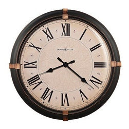 Howard Miller 625-498 Atwater 24 in. Wall Clock - Who knew the Howard Miller 625-498 Atwater 24 in. Wall Clock could add such a strong traditional feeling to your home or office? The oversized dark rubbed bronze metal and glass wall clock is full of sophisticated warmth from the aged bronze accents to the fine twisted metal ring that frames the aged face. The Roman numerals are complemented by black spade hands and delicate printed flourishes as half-hour markers. The quartz movement requires one AA battery (not included). Make a statement with the Atwater clock from Howard Miller. The Howard Miller StoryIncomparable workmanship unsurpassed quality and a quest for perfection - these were the cornerstones of the company Howard C. Miller founded in 1926 at the age of 21. Even then Howard Miller understood the need to create products that would be steeped in quality and value. Howard Miller was schooled in the fine art of clockmaking by his father Herman in the Black Forest region of Germany. Howard developed into a visionary whose keen sense of innovation spawned a tradition of excellence that has been uncompromised through three generations. A highly respected brand Howard Miller maintains its popularity because of the company's commitment to quality. Every product manufactured at the company's sprawling facility in Zeeland Michigan undergoes stringent tests and exceeds industry standards to ensure a lifetime of enjoyment.