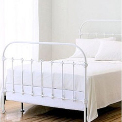 Kensington Iron Bed - This beautiful wrought-iron bed is sure to become a treasured piece, passed down for generations to come.