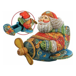 "Aviator Santa Claus Artistic Wood Carved Sculpture - Measures 5""H x 5""L x 4""W and weighs 1 lb. G. DeBrekht fine art traditional, vintage style sculpted figures are delightful and imaginative. Each figurine is artistically hand-painted with detailed scenes including classic Christmas art, winter wonderlands and the true meaning of Christmas, nativity art. In the spirit of giving G.DeBrekht holiday decor makes beautiful collectible Christmas and holiday gifts to share with loved ones. Every G. DeBrekht holiday decoration is an original work of art sure to be cherished as a family tradition and treasured by future generations. Some items may have slight variations of the decoration on the decor due to the hand painted nature of the product. Decorating your home for Christmas is a special time for families. With G. DeBrekht holiday home decor and decorations you can choose your style and create a true holiday gallery of art for your family to enjoy."