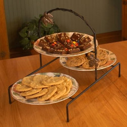 J & J Wire Triple Serving Vine & Leaf Rack - Better than any food pyramid the health department will ever publish the J & J Wire Triple Serving Vine & Leaf Rack has two tiers with two trays on the bottom and one on top for showcasing your goodies on 9-inch or 11-inch plates (not included). Use it as the focal point of a bountiful holiday buffet or place it directly on the dining table for serving. Proudly made in the USA from wrought iron with a black powder-coat finish this lovely serving rack features an antique gold vine and leaf design on the handle for an elegant touch.About J & J Wire Inc.Located at the Industrial Park in Beatrice Nebraska J & J Wire Inc. started 25 years ago as a wire-forming business manufacturing mostly houseware items. Since then the company has grown into a metal fabrication business serving customers in many different manufacturing sectors in the United States and Canada. From quilt racks to wine racks J & J Wire is committed to creating handmade works of art at affordable prices.