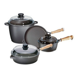 "Berndes - Tradition 7 Pc Cast Aluminum Non-Stick Cookwa - Set includes:. 9.5 in. Dia. Skillet. 11 in. Dia. Saute pan with glass lid. 2 qt. Saucepan with glass lid. 7 qt. Stock pot with glass lid. Ergonomically designed, distinctive natural wood handle (Ash). Will not warp. Heats evenly and quickly. Cooking surface is finished with a triple layer and exterior with a double layer of Dupont ""Autograph 2 Gourmet Non-Stick"". Pyrex high-dome lids. Vacuum cast aluminum body is energy efficient. European design and style"