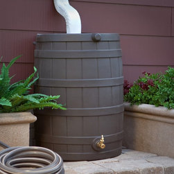 Good Ideas - Plastic Rain Barrel: Good Ideas 40 Gallon Plastic Rain Wizard Flat Back Rain Bar - Shop for Watering Equipment from Hayneedle.com! The Good Ideas Rain Wizard Resin Rain Flat Back Rain Barrel is a stylish and easy way to catch and store rainwater that would normally just drain onto the ground and be lost. All you have to do is position this molded plastic barrel under your down spout and water will pass through the screen and into the barrel for use later. The use of the screen means water gets in but debris and insects don't. Thanks to the flat back design of the barrel it will sit right against the house and take up less space on your walkway or patio. Child and pet proof this rain barrel will hold up to 40 gallons of pure rainwater which can be used to water gardens and potted plants. It can also be linked to other Rain Wizards by using a link kit (sold separately) to increase water capacity. This barrel features a shut-off valve for hose hook-up or dual overflow. Made of weather-resistant resin (the black option is recycled plastic) this rain barrel is resistant to rust mold mildew rotting UV rays fading and deterioration. The spigot is made of high-quality brass which lasts longer and is more reliable than plastic spigots found on other models. Especially useful during dry seasons the Rain Wizard is a smart and inexpensive investment that will pay for itself several times over in water bill savings. Please note - the brass spigot is included with your rain barrel. It is shipped inside the barrel - remove before use. An Eco-friendly Practice: Using a rain barrel is one way you can become more environmentally conscious. Saving rain water reduces the amount of usable water you need which decreases demand for treated water and saves you money. Because the rain barrel catches water that would normally flow to the ground it also helps the environment by reducing runoff waste water. Storing rain water can also supply you with an alternative water source du