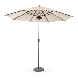 "Coral Coast 9 ft. Olefin Auto Tilt Aluminum Patio Umbrella with FREE Umbrella Li - Try as you might you simply won't find a more affordable auto tilt patio umbrella with a durable Olefin fabric shade than the Coral Coast 9 ft. Auto Tilt Aluminum Patio Umbrella. It's all in the engineering. This unique umbrella raises the tilt joint position on the frame (tilt mechanism). This unique design distributes weight away from the joint resulting in a far lower chance of breakage compared to other auto-tilt products. This allows the tilt joint to be made from a lighter weight material instead of costly metal. The auto-tilt feature conveniently allows you to adjust the pitch of the umbrella shade to block the sun. Simply use the crank to open the umbrella then continue turning until you get to the desired shade pitch. """"How could this get any better?"""" you ask...because this umbrella also comes with a FREE black rechargeable umbrella light! The Coral Coast 9in. LED Rechargeable Umbrella Light lights up the night for extended patio conversations. The battery-operated light clips onto a patio umbrella with ease. You can mount the light to shine either upward or downward. When it shines upward the light reflects off the umbrella shade for a dazzling effect. Available in black. Includes three rechargeable AA batteries and an A/C adapter. To enjoy the auto tilt feature simply crank the umbrella until the canopy is fully opened then continue to crank until the umbrella shade reaches the desired tilted position. The solution-dyed Olefin shade is a hardwearing fabric that will last several seasons and you have several colors to choose from. Each one will look handsome paired with the textured aluminum pole in a bronze finish."