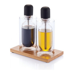 Modern Glass Pip Oil + Vinegar Set - Pip by XD Design is the oil & vinegar set ideal for all those who love to season their plates excatly, with no waste of sort.