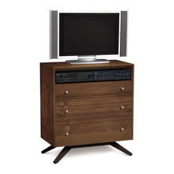 Copeland Furniture - Copeland Furniture   Astrid Three-Drawer Dresser + TV Organizer - Made in Vermont by Copeland Furniture.With its deeply splayed legs producing dramatic cantilevers, the Astrid Bedroom is an engineering feat that defies expectations and inspires a sense of possibility.The Astrid Three-Drawer Dresser + TV Organizer is crafted in solid cherry hardwood, maple wood, or in a combination of solid walnut and dark chocolate maple with brushed nickel hourglass knobs. Construction features include asymmetrical English dovetail joints, solid hardwood drawer sides, fully finished drawer boxes with finished/sanded interiors, glued in place drawer bottoms and under-mounted, soft-close drawer slides.Select from a range of wood finishes, then select one of two satin surface finishes: standard Copeland Lacquer top coat or formaldehyde free Copeland Water Based top coat.The Astrid Three-Drawer Dresser + TV Organizer by Copeland Furniture is crafted from sustainably harvested hardwoods from the American Northern Forest. All lumber used by Copeland Furniture comes from within 500 miles of their factory in Vermont, thus reducing fossil fuel consumption and carbon dioxide emissions from transportation. The environmental values of preservation and stewardship are reflected in every piece of furniture produced by Copeland Furniture.