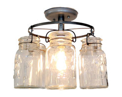 Vintage Mason Jar Ceiling Light - It features a series of 6 true, authentic vintage mason jars suspended in a circle, showing off each jar. The light thru the jars is bounced off of each trademark.