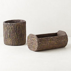 Moss Log Garden Pot - Take a nature walk this weekend and fill up these log garden pots with fuzzy moss instead of using your usual floral arrangement. Moss also has a bonus compared to a bouquet of flowers: it doesn't dry up too quickly while sitting over a roaring fire.