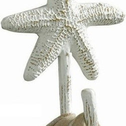 Tropical Nautical Starfish Single Wall Towel Hook - There is one — I repeat, one — towel rack in the bathroom, and it's not even in the small hall bathroom. Sure, there are a couple of hooks on the back of the bathroom door, but the new hall bathroom will need some more towel hanging space. This starfish hook screams beachy chic, and it will look great in a group of three on the freshly painted walls.