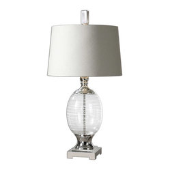 Uttermost - Pateros Swirl Glass Lamp - Sophisticated glamour has entered the house. Your house. Heat up your decor with this chic stylish table lamp. The clear glass base is accented with white swirls and a polished nickel foot and finial. The off-white linen tapered shade has a silver liner for elegance and drama.