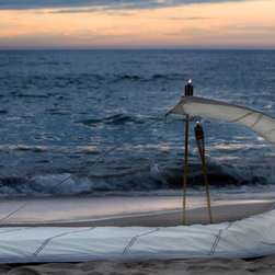 Vaurien - How unique is this recycled sailcloth lounge? Although it may look uncomfortable, the company claims that the curve acts as support for the head. How perfect would it be at a beach house?