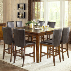 """Steve Silver Furniture - Davenport 9 Piece Counter Height Dining Set - The Davenport Counter Height Table and Chairs offers a beautiful tobacco finish, casual styling with slate inlay and comes together to create the perfect blend of beauty and functionality. Features: -Set includes counter height dining table and eight dining chairs. -Davenport collection. -Tobacco finish. -Solid wood construction. -Contemporary style. -Corner blocked. -Tongue and groove joints. -18"""" Extension leaf. -Table has slate inlay. -Manufacturer provides one year limited warranty. Dimensions: -Overall Table Dimensions: 37"""" H x 54"""" W x 54"""" D. -Overall Counter Height Dining Chair Dimensions: 42"""" H x 19"""" W x 22"""" D. -Overall Ladder Back Counter Height Dining Chair Dimensions: 43"""" H x 19"""" W x 23"""" D. -Seat height: 24""""."""