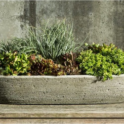 Campania International - Campania International Barca Cast Stone Planter - L-033-AL - Shop for Planters and Pottery from Hayneedle.com! Sleek and slim the Campania International Barca Cast Stone Planter is perfect for growing succulents and adding rustic organic style to your setting. This contemporary planter is crafted of cast stone and is durable enough to withstand the elements nicely. It has a textural look that draws the eye and comes in a wide variety of finish options. Campania Cast Stone: The ProcessThe creation of Campania's cast stone pieces begins and ends by hand. From the creation of an original design making of a mold pouring the cast stone application of the patina to the final packing of an order the process is both technical and artistic. As many as 30 pairs of hands are involved in the creation of each Campania piece in a labor intensive 15 step process.The process begins either with the creation of an original copyrighted design by Campania's artisans or an antique original. Antique originals will often require some restoration work which is also done in-house by expert craftsmen. Campania's mold making department will then begin a multi-step process to create a production mold which will properly replicate the detail and texture of the original piece. Depending on its size and complexity a mold can take as long as three months to complete. Campania creates in excess of 700 molds per year.After a mold is completed it is moved to the production area where a team individually hand pours the liquid cast stone mixture into the mold and employs special techniques to remove air bubbles. Campania carefully monitors the PSI of every piece. PSI (pounds per square inch) measures the strength of every piece to ensure durability. The PSI of Campania pieces is currently engineered at approximately 7500 for optimum strength. Each piece is air-dried and then de-molded by hand. After an internal quality check pieces are sent to a finishing department where seams are ground and any air holes caused by the pouring process are filled and smoothed. Pieces are then placed on a pallet for stocking in the warehouse.All Campania pieces are produced and stocked in natural cast stone. When a customer's order is placed pieces are pulled and unless a piece is requested in natural cast stone it is finished in a unique patinas. All patinas are applied by hand in a multi-step process; some patinas require three separate color applications. A finisher's skill in applying the patina and wiping away any excess to highlight detail requires not only technical skill but also true artistic sensibility. Every Campania piece becomes a unique and original work of garden art as a result.After the patina is dry the piece is then quality inspected. All pieces of a customer's order are batched and checked for completeness. A two-person packing team will then pack the order by hand into gaylord boxes on pallets. The packing material used is excelsior a natural wood product that has no chemical additives and may be recycled as display material repacking customer orders mulch or even bedding for animals. This exhaustive process ensures that Campania will remain a popular and beloved choice when it comes to garden decor.About Campania InternationalEstablished in 1984 Campania International's reputation has been built on quality original products and service. Originally selling terra cotta planters Campania soon began to research and develop the design and manufacture of cast stone garden planters and ornaments. Campania is also an importer and wholesaler of garden products including polyethylene terra cotta glazed pottery cast iron and fiberglass planters as well as classic garden structures fountains and cast resin statuary.