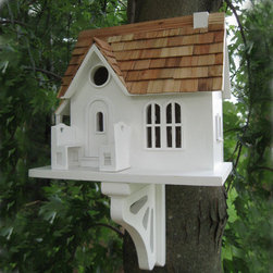 Cozy Cottage Bird House - White with Pine Shingle Roof - The Cozy Cottage Bird House is the perfect starter home for your feathered friends. Pine shingles, arched windows and two adorable lovebird benches are a few features of this beautiful cottage.