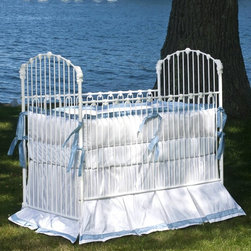Corsican - Corsican Heirloom Iron Crib - 40554-101 - Shop for Cribs from Hayneedle.com! If you want a custom-made crib you could someday pass down to your children for their own babies get the Corsican Heirloom Iron Crib. Wooden cribs are fine but they won't last for generations like this beautiful hand-forged wrought iron crib. Each Corsican crib is custom made by craftsmen with a commitment to quality and is available in a variety of hand-applied finishes. The narrow slats on this crib are accented at the side rails and head and foot of the bed for a classic look. The side rails are stationary for your baby's safety and the mattress height is adjustable for your convenience. It fits a standard crib mattress (not included). Note: This item can only be shipped within the 48 contiguous states. Dimensions: Crib: 54L x 30W x 53H in. Headboard/Footboard: 53H in. Side rails: 40H in. JPMA certified (requirements developed and published by ASTM International). About CorsicanWith a commitment to quality and attention to detail Corsican has been manufacturing iron furniture and accessories for more than 40 years. Their skilled craftsmen uphold a tradition of handcrafted beauty personal care and attention to detail.