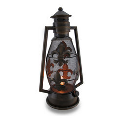 Bronze Finish Fleur De Lis Metal Lantern Style Hurricane Accent Lamp - Perfect for lantern lovers, this metal lantern style hurricane lamp will accent your home in rustic style with its hand-painted distressed bronze finish. Made from metal, it features Fleur de Lis symbol accents on the mesh globe, and it looks just like a vintage kerosene lantern. This lantern lamp is great for accenting a side table, softly lighting up the entryway or bedroom, or bringing a bit of light to your enclosed porch. It's 15 inches tall and 8 inches long with a 5.75 inch diameter (38 X 20 X 14 cm) base. It uses 1 nightlight style bulb (included), and easily turns on or off via the in-line thumbwheel switch on the 54 inch long black cord. This accent lamp is great as a housewarming gift sure to admired!
