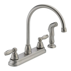 Peerless - Peerless Apex P299575LF Double Handle Kitchen Faucet with Side Spray - 547039 - Shop for Kitchen from Hayneedle.com! Classic style and innovative design make the Peerless Apex P299575LF Double Handle Kitchen Faucet with Side Spray perfect for your kitchen. Thanks to its solid brass construction this faucet is prepared to take on bacteria and rust to keep your kitchen cooking. The high-arcing and swiveling spout allows the large pots and pans to slip easily into the basin. Just pull out the side sprayer to rinse dishes and produce with total convenience. You can precisely dial in the ideal temperature and pressure with the pair of smoothly turning handles. Product Specifications: Mount Type: Deck Mount Handle Style: Lever Valve Type: Ceramic Disc Flow Rate (GPM): 1.8 Swivel: 360 degrees Spout Height: 6.63-inch Spout Reach: 8.125-inch About Peerless IndustriesBased in Melrose Park IL Peerless Industries is a leading provider of audiovisual mounting solutions for commercial and residential uses. For over 40 years Peerless has focused on quality ease of installation and functionality in all its products. Peerless mounts and installation accessories feature aesthetically pleasing designs that fade into the background gracefully accentuating your viewing experience. With such a comprehensive line of products Peerless is sure to offer a mount that will perfectly suit your needs.