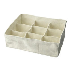 Carina Bengs - Komplement Storage with Compartments - Roll em up and put 'em away. Clean socks by the pair.
