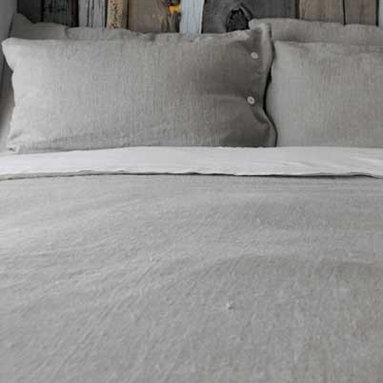 Orkney Natural Duvet Cover - These rough linen sheets in a soft French gray would be my idea of heaven to fall asleep in.