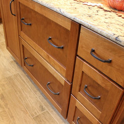 Cherry Cabinets with Quartz Countertop ~ Strongsville, OH #1 - In this kitchen renovation we installed Medallion Silverline Lancaster Cherry Cabinets with Chestnut stain accented with a Medallion Gold Potters Mill Cherry Mission arched valance 4x60 with Chestnut stain accented with Amerock caramel bronze pull.  For the countertops, we installed Cambria Quartz surfacing in Bradshaw color with bullnose edge.  The backsplash was created using 3x6 Durango tile with Daltile stone radiance glass and stone pieces with a pearl grout.  An Elkay sink with Kohler stainless steel faucet.  On the floor porcelain wood look tile in light Chocolate was installed.