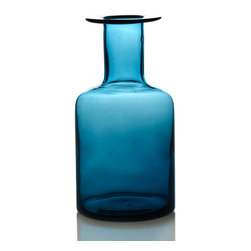 Small Bluebottle Vase - A little vintage, a little modern, these blue glass vases give a spot of color to contrast to flowers or slim taper candles. Small bubbles and lines give each vase a unique, handmade look.