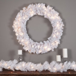 East West Basics (HK) Ltd - 36 in. Winter Park Pre-lit Wreath Multicolor - TI920-W440BE-100LC - Shop for Holiday Ornaments and Decor from Hayneedle.com! Dramatic and exquisite the 36 in. Winter Park Pre-Lit Wreath is an excellent choice for your holiday decorating this year. With 440 tips this wreath offers plenty of room to hang your favorite decorations and the striking white foliage creates a stunning backdrop for any color. It's pre-lit with 100 lights so it's ready to hang whenever you are. Cord Length on wreath is 28 inches long. Care instructions: While in use be sure to keep this product out of direct sunlight to avoid discoloration. When in storage keep this product covered as dust build-up may also cause an undesirable discoloration. Follow these directions for years of enjoyable use.