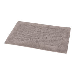 Prestige Cotton Bath Rug Karma Brown Glaze - This prestige cotton bath rug Karma is 100% cotton. Ultra-soft, deep, and inviting, this bath mat is a rug you can luxuriously sink your toes in and will give a sophisticated look to any bathroom. This beautiful bath rug features an eye-catching design with its outlined plush border. It provides a soft, cushioned feel, shock absorption and is durable. Manufacturer recommends using a nonskid pad beneath the rug (not included). Hand wash and no dryer. Indoor use only. Width 20-Inch and length 31.5-Inch. Color brown glaze. Enhance your bathroom decor with this handsome prestige bath rug and add an understated elegance to your space. Imported.