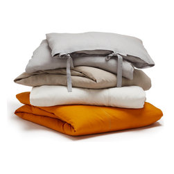 Coyuchi Relaxed Linen Duvet Covers - Laid-back luxury The Relaxed Linen Duvet Cover invites you to wrap up in it and relax. All-natural linen just gets better with age, getting softer and more lustrous with every wash. Layer it with crisp percale or smooth sateen for a truly luxurious feeling. The duvet cover features simple, pieced construction accented with contrast stitching and an 8-inch interior flap and inside ties; closes with wide self-ties. Available in three colors and two sizes.  Available colors: Natural, Sunwashed Tangerine, White and Pewter Dimensions: Full/Queen - 86W x 86L, King - 100W x 86L Care: All of our cotton & linen products are machine washable. We recommend using warm water and non-phosphate soap in the washing cycle, with a cool, tumble or line dry. The use of bleaching agents may diminish the brilliance and depth of the colors, so we recommend not using any whiteners.