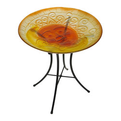 Zeckos - Celestial Sun and Moon Colorful Glass Bird Bath - When you display this colorful birdbath on your patio, in the garden or just on the back lawn, you'll have your own bevy of birds flocking to play in your yard Crafted from glass, the 17.75 inch (45 cm) diameter, 3 inch (8 cm) deep bowl features an embossed smiling celestial sun and moon in bright orange hues, and includes suction cups to secure the bowl to the metal collapsible stand. At 24 inches (61 cm) high, it would look great near a pond or pool, too It makes a wonderful gift for a bird watching friend or any avian enthusiasts
