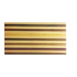 "Exotic Chopping Blocks - 7"" x 14"" Bread Board - This board is sophisticated in its simplicity, yet still has the right amount  of color to make it stand out. The main white wood in this board is Maple from North America. The colorful woods include Bocate from Mexico, and Purple Heart and Yellow Heart from South America, and Dark Walnut from North America.  All the woods are their natural colors. There has been no paint or stain added."