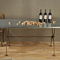 Bobo Intriguing Objects Folding Zinc Table - This gorgeous table combines the polish of zinc with the patina of iron. Bonus: it folds up for easy storage when not in use.