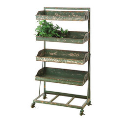 Annie Four-Tier Shelf - In your home, this sweetly distressed green metal shelf holds up your favorite decor and memorabilia with rustic charm. The sturdy frame stands on a wheeled base, so it's well adapted to moving around the kitchen. It would also work wonders outdoors for sorting out plant starts and garden equipment.
