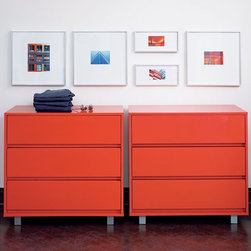 "Shop Chest CB2 - This modern chest of drawers has a sleek powdercoating that makes it look like it's from a tricked-out workshop. Add it as a single or buy a pair to serve as a longer console or to flank your bed as nightstands with massive storage potential.Hi-gloss lobster red lacquer over wood compositeMetal legs with a gunmetal powdercoat finishThree drawers on metal glides have groove underneath to pull out; no hardware36""Wx18""Dx34""H"