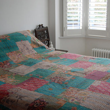 Kantha Quilt - Turquoise/Multi - Striking patchwork kantha quilt. Double stitched to create a stunning texture and appearance, this bedspread is lined with a plain coordinating fabric. Each one of these bedcovers is lovingly handcrafted by artisans and items of this quality are not easily available.