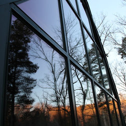 Sunset on Window Glass - These large windows were custom framed and wrapped with aluminum cladding to reduce maintenance. © Door Store and Windows, Louisville, KY