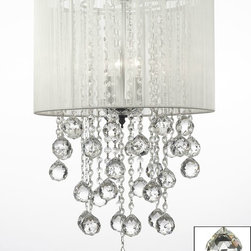 "The Gallery - Crystal Chandelier With Large White Shade & Balls H24"" X W15"" - 100% Crystal Chandelier. A Great European Tradition. Nothing is quite as elegant as the fine crystal chandeliers that gave sparkle to brilliant evenings at palaces and manor houses across Europe. This beautiful chandelier has 3 lights and is decorated and draped with 100% crystal that capture and reflect the light of the candle bulbs. This wonderful chandelier also comes with the large shade as shown. The timeless elegance of this chandelier is sure to lend a special atmosphere anywhere its placed! This chandelier is dressed with spectacular crystal balls which take the sparkle to an entirely new level of brilliance! **SHADE INCLUDED** W15"" H24"" 3 LIGHTS"