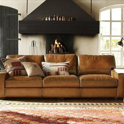 "Turner Sofa, Leather Saddle - Supple leather lends an earthy warmth to this collection. The top-grain hide is meticulously dyed and burnished for color that grows darker at each edge and corner. The sofa is styled with a high back, thick squared-off arms and plump seat cushions. 104.5"" w x 44"" d x 35"" h {{link path='pages/popups/PB-FG-Turner-2.html' class='popup' width='720' height='800'}}View the dimension diagram for more information{{/link}}. {{link path='pages/popups/PB-FG-Turner-3.html' class='popup' width='720' height='800'}}The fit & measuring guide should be read prior to placing your order{{/link}}. Seat cushions are wrapped in a down-blend for a casual and relaxed look. For shipping and return information, click on the shipping info tab."