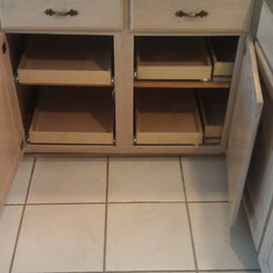 ShelfGenie Glide-Out Shelves - This cabinet features our blind corner solution which helps to better utilize the storage area within your corner cabinets.