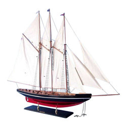 """Handcrafted Nautical Decor - Atlantic 50"""" - Wood Model Yacht Model - Not a model ship kit. Attach sails and Atlantic model yachts are Ready for Immediate Display. A smooth painted hull and finely-crafted yet understated features lend these commanding model yachts of the famous Atlantic schooner a noble elegance. Inspiring a proud and winning spirit, these wooden model sailboats add a flair of nautical decor to the theme of any office, boardroom, den or living room with subdued grace. 50"""" L x 8"""" W x 40"""" H (1:55 scale)."""