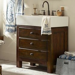 """Mason Single Sink Console, Rustic Mahogany finish - A rich mahogany stain is paired with creamy white porcelain to create a beautiful contrast of color in our Mason console. Perfect for smaller spaces, it has deep drawers for ample storage, and the top drawer is divided into compartments to organize toiletries. 31.5"""" wide x 18"""" deep x 36"""" high Expertly crafted of solid poplar. Hand finished in Rustic Mahogany and sealed with a protective lacquer for moisture resistance. Porcelain farmhouse sink. Features three drawers built with English dovetail joinery Top two drawers each have three compartments. Use with any of our faucet collections (sold separately). Professional installation required. View our {{link path='pages/popups/fb-bath.html' class='popup' width='480' height='300'}}Furniture Brochure{{/link}}."""