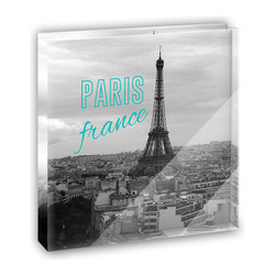 """Made on Terra - Paris France Eiffel Tower Mini Desk Plaque and Paperweight - You glance over at your miniature acrylic plaque and your spirits are instantly lifted. It's just too cute! From it's petite size to the unique design, it's the perfect punctuation for your shelf or desk, depending on where you want to place it at that moment. At this moment, it's standing up on its own, but you know it also looks great flat on a desk as a paper weight. Choose from Made on Terra's many wonderful acrylic decorations. Measures approximately 4"""" width x 4"""" in length x 1/2"""" in depth. Made of acrylic. Artwork is printed on the back for a cool effect. Self-standing."""