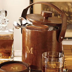 Saddle Leather Lidded Ice Bucket & Tongs - This is so Mad Men, but who wouldn't want to mix some drinks with this very sophisticated ice bucket? And look at the stitching on those tongs!