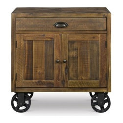 River Ridge 2-Door 1 Drawer Nightstand with Casters - Distressed Natural - You don't have to visit the wild west to get the rustic, timeworn charm of the River Ridge 2-Door 1 Drawer Nightstand with Casters - Distressed Natural. This handy nightstand features two doors and one drawer to store bedside items close at hand. The chunky metal hardware beautifully complements the rough-hewn appearance and distressed natural finish. Industrial casters add a bit of urban flair, making this piece a beautiful part of the River Ridge collection.About Magnussen FurnitureFrom its beginning as a small furniture company in Ontario, Canada, Magnussen Furniture has evolved into a full-line furniture resource with offices in Canada, the United States, and the Far East. Their business is creating furniture designs of exceptional style, value, and beauty. They produce these designs in partnership with manufacturing partners around the world that meet exacting standards for superior quality at the best possible value.