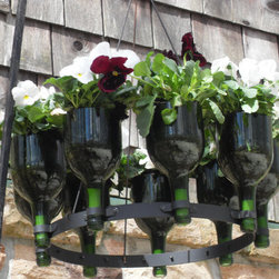 Rainville Design - A handmade upside down wine bottle chandelier rack of nine recycled Bordeaux style wine bottles created to make a unique decorative piece for your home. This chandelier can become a planter or an ornamental piece to suit any occasion or any season. Indoors or out, this chandelier will bring you year-round enjoyment.