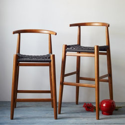 John Vogel Bar + Counter Stool - These bar stools with a midcentury-inspired shape, gorgeous wood and a woven seat will jazz up any counter.