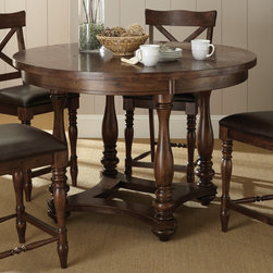 """Steve Silver Furniture - Steve Silver Wyndham Round Counter Table in Distressed Tobacco - The Wyndham Dining Collection adds a rustic country charm to any dining area  with modern touches that even the most sophisticated home decorator will love. The 36"""" high Wyndham counter table has a 54"""" round top  seating four comfortably."""
